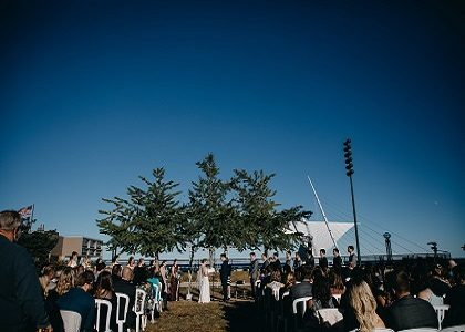 Lake Michigan lakefront outdoor wedding of Zilli Lake and Gardens wedding couple by the Milwaukee Art Museum