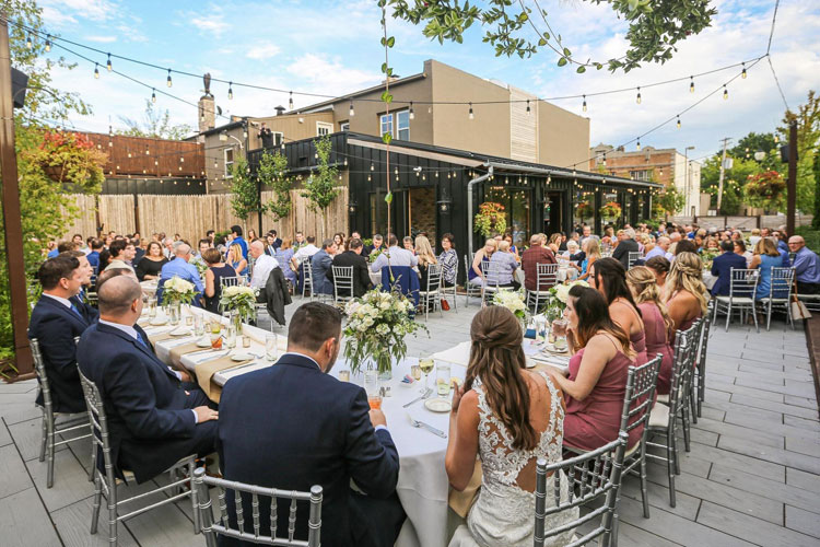 Outdoor Wedding Reception on Patio with Lights
