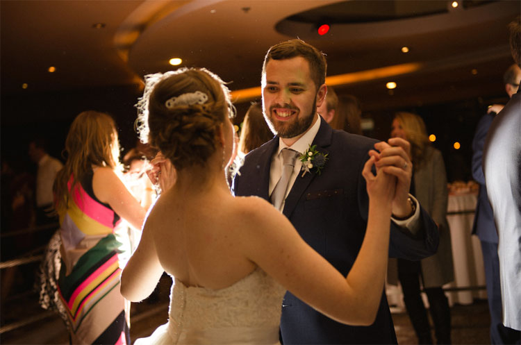 Bride and Groom Dance on the Dance Floor at Coast