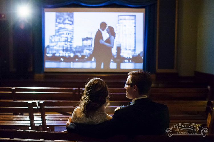 Bride and Groom in Pastime Theatre Watching Slideshow