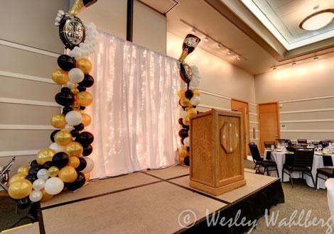balloons behind podium
