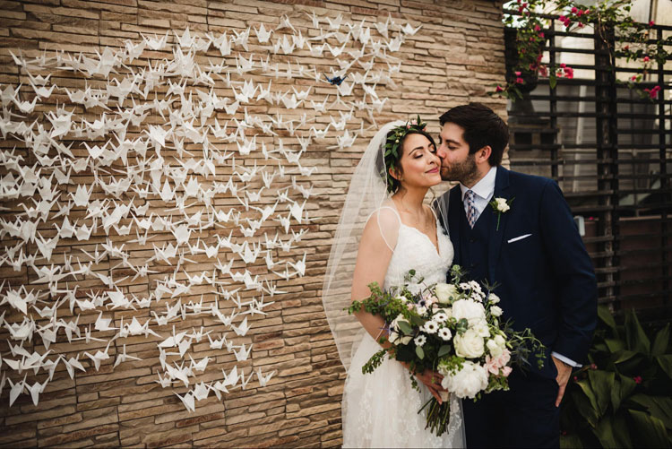Geometric Cranes Backdrop with Bride and Groom